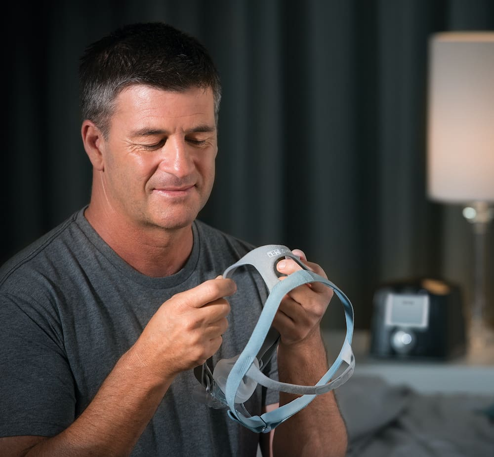 Man looking at a ESON 2 mask