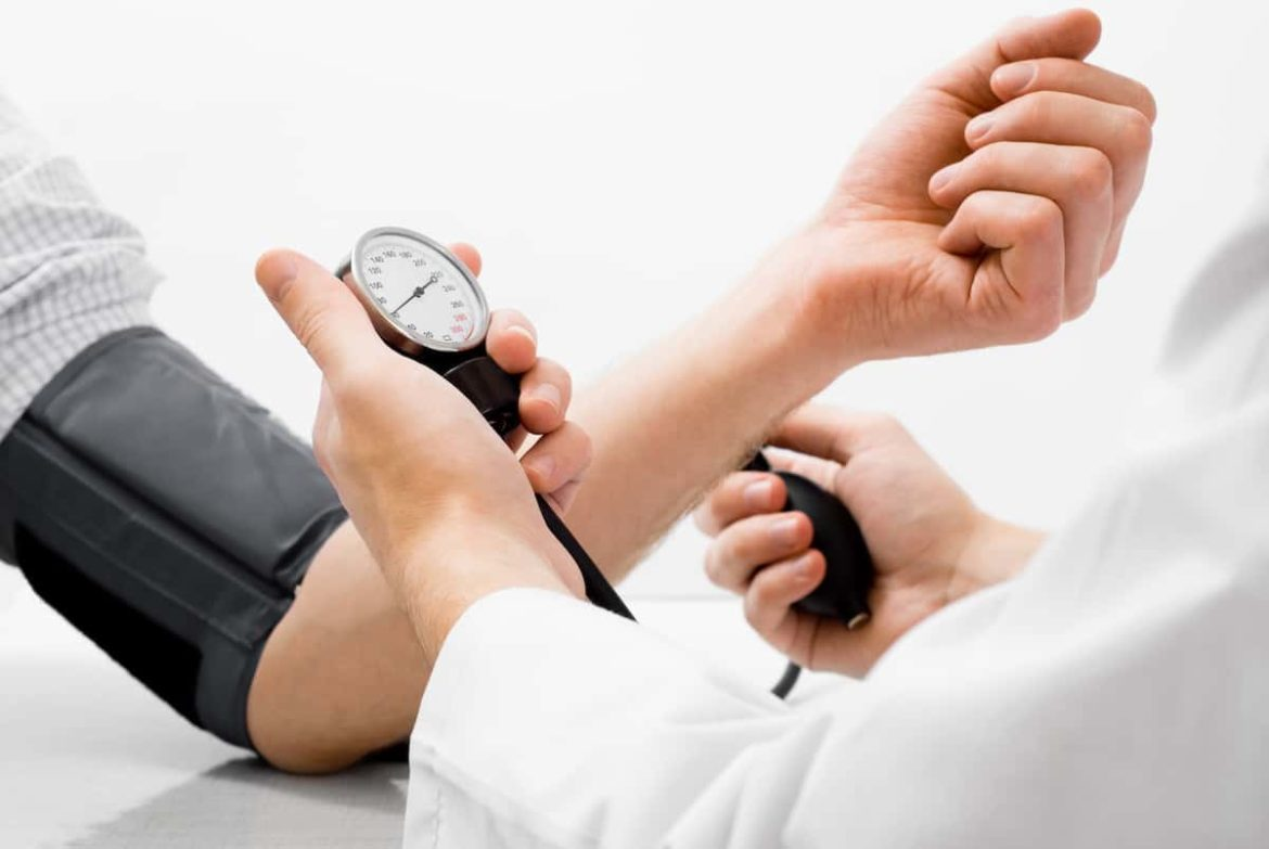 Doctor using a blood pressure device on a patient