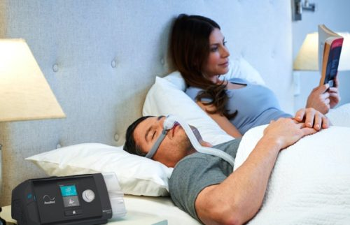 couple in bed man wearing Airfit p10