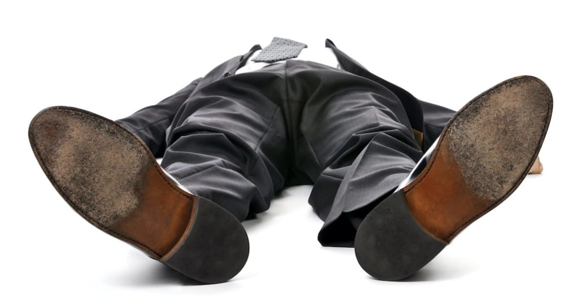 body of someone who has collapsed on the ground