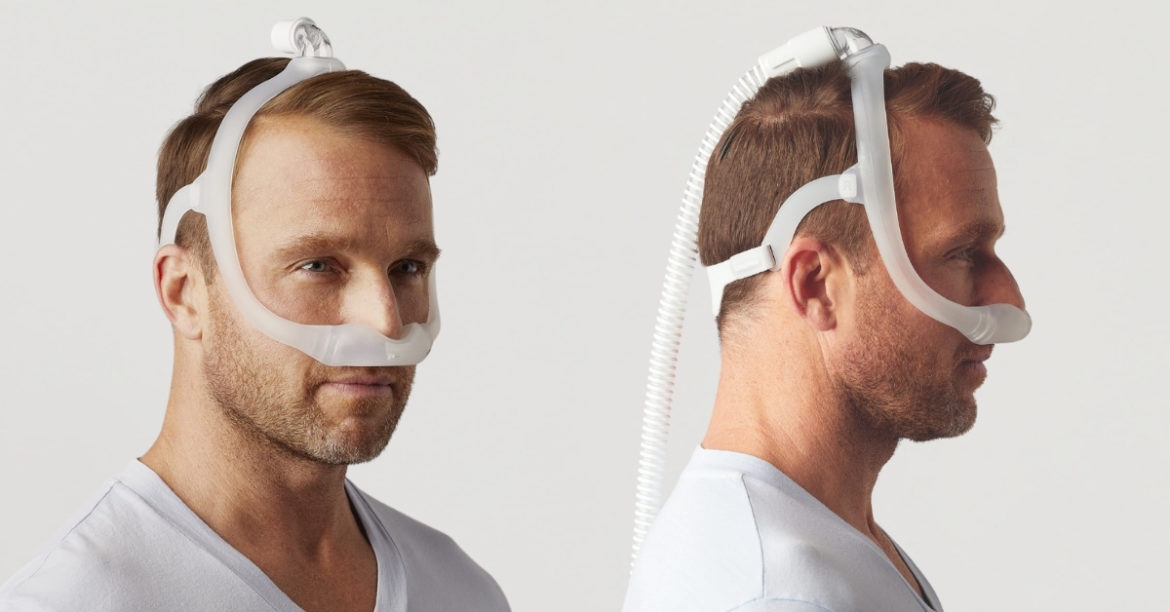 Two angled view of man wearing a Dreamwear nasal mask