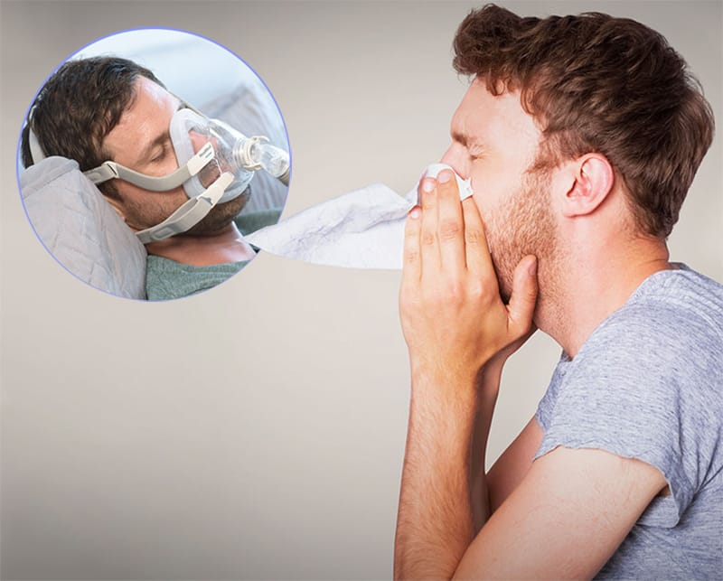 man blowing nose with a image of him wearing a CPAP mask in the corner