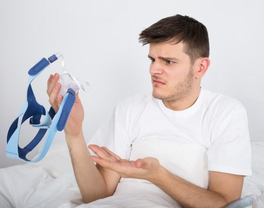 man holding cpap e1610479937791