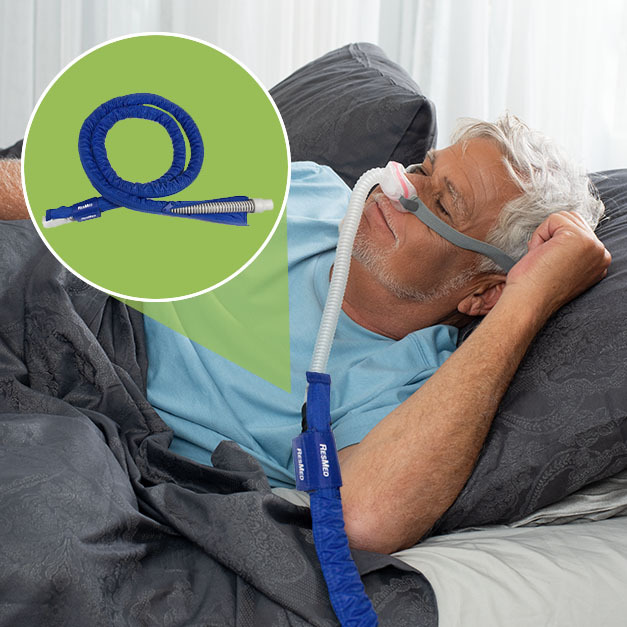 sleeping man wearing a CPAP mask, with a cover on his CPAP tubing