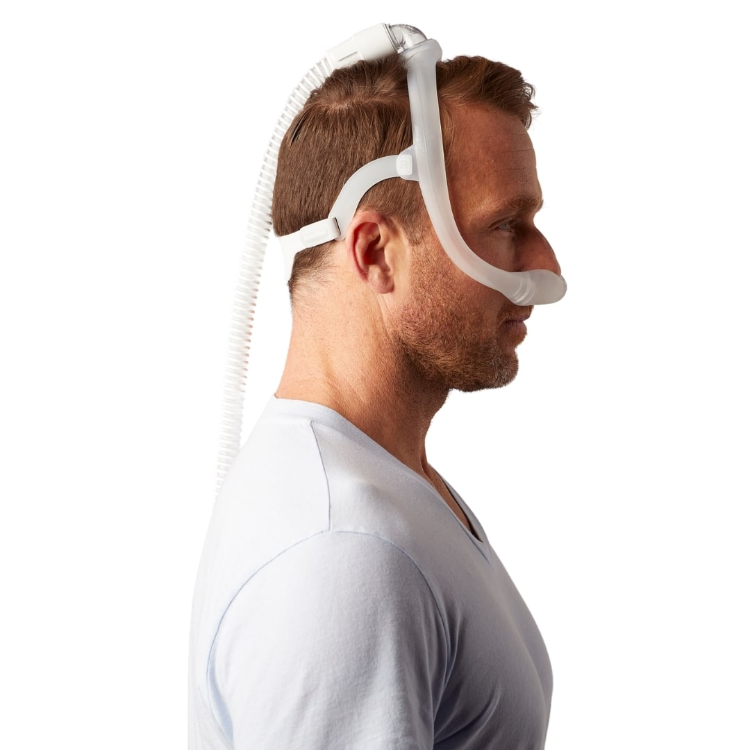 Side view of a man wearing the Dreamwear nasal mask