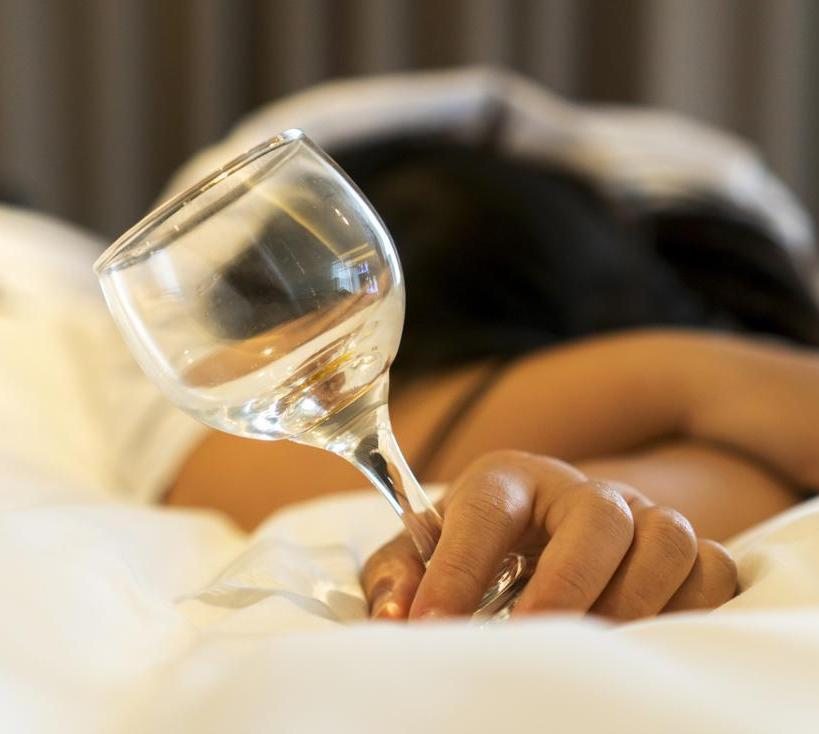 woman asleep with empty glass